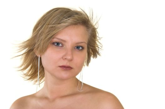 Head and shoulders portrait of a pretty young woman looking at you; naked shoulders; wind blown hair; isolated on white.
