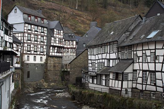 Remark for inspector: _Galthaus_ is a generic word in German like _Hotel_ (it is a kind of a hotel), it's not a brand name or a title.  Historic center of Monschau village (Germany) at the Rur river.