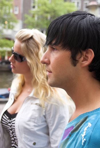 profile portrait of a young adult couple outdoors