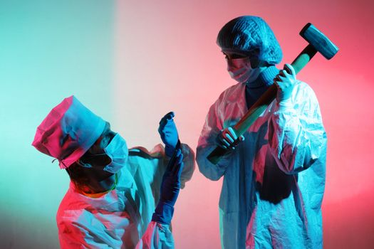 Doctors with a sledgehammer on a abstract dirty colored background