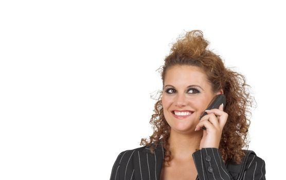 Pretty business woman talking on cell phone; smiling
