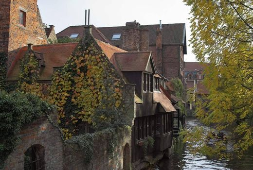 Ancient houses on a channel in Brugge (Bruges), Belgium