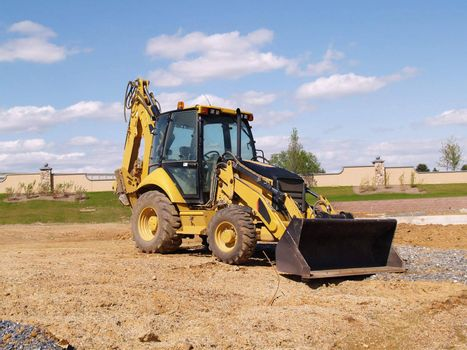 a front end loader construction equipment at a construction site
