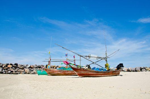 Coastal fishing boats waiting at the water to catch fish. Hua Hin, Thailand.