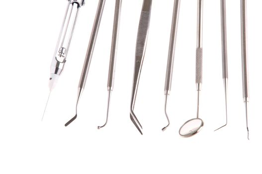 stainless steel dental surgery instruments for teeth care (isolated on white background)