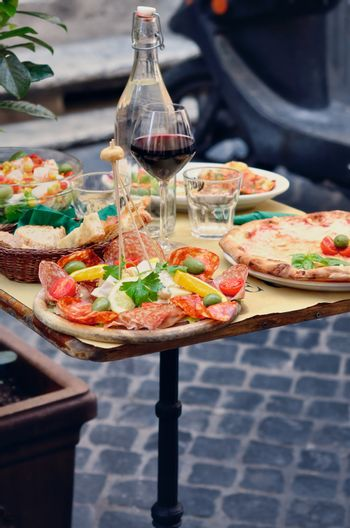 Table with light snack on the street in Italy