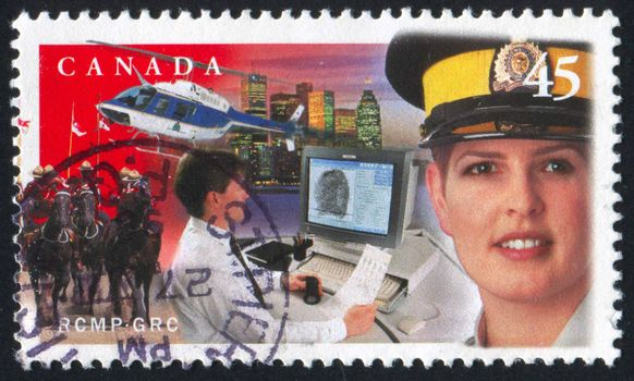 CANADA - CIRCA 1998: stamp printed by Canada, shows Female mountie, helicopter, cityscape, circa 1998