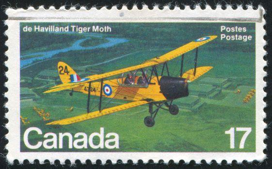 CANADA - CIRCA 1981: stamp printed by Canada, shows aeroplane, de Havilland Tiger Moth, circa 1981