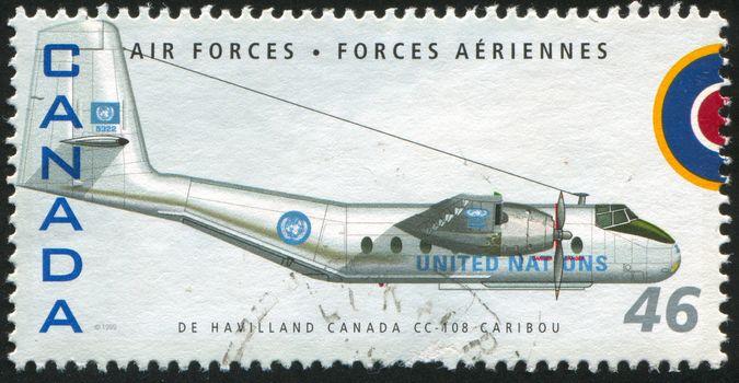 CANADA - CIRCA 1999: stamp printed by Canada, shows aeroplane, De Havilland Canada CC-108 Caribou, circa 1999