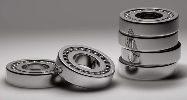 Concept of team working together, with a silver gear steel bearings working together.