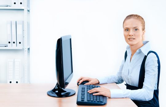 Woman works at the computer. Screen has a clipping path.