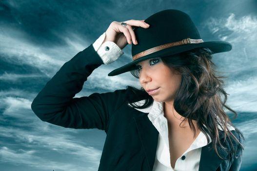 Beautiful woman in cowboy hat.