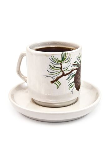 Porcelain cup with coffee