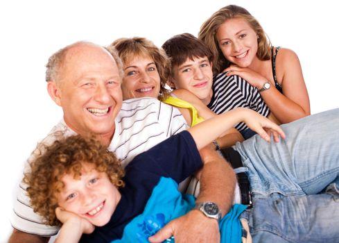 Happy family having fun together lying in studio, posing...