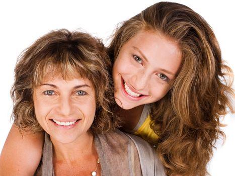 Close-up of smiling elder mum and daughter facing camera...