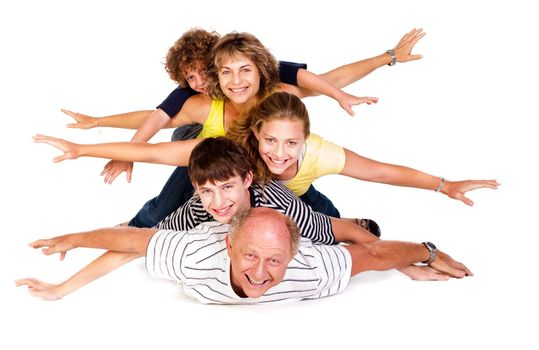 Cheerful family having fun in the studio isolated over the white background..