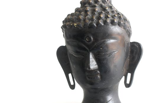 Isolated shot of Buddha's bust on white