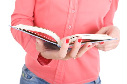 opened book in the hands of the girl