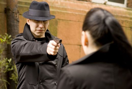 man threatens the woman with gun