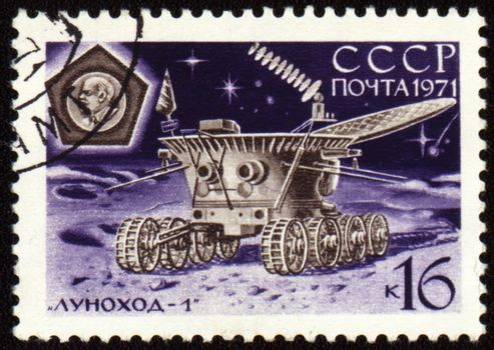 Postage stamp printed in USSR shows soviet moon machine Lunokhod-1 on Lunar surface