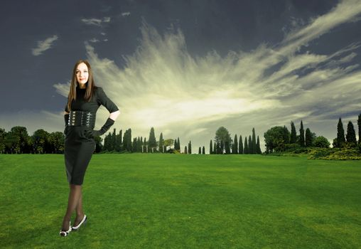 photo of sexy elegant woman on a green field with sunlight