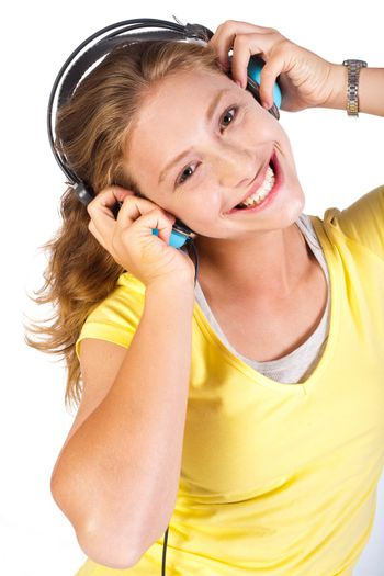 Attractive girl enjoying music with dj headphones.