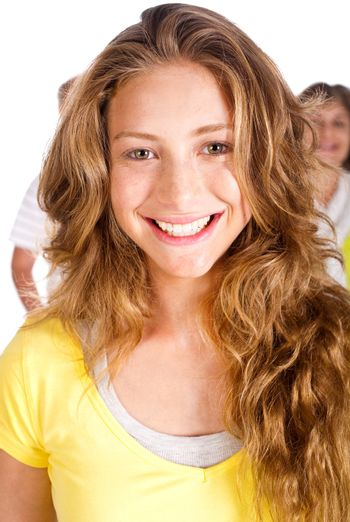 Gorgeous young woman smiling at camera, closeup, with her parents in the background..