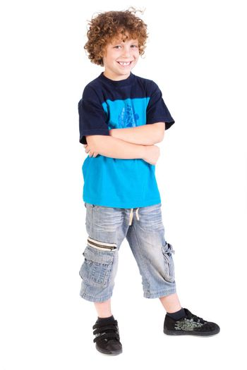 Young preschool boy posing with arms crossed isolated on white background...