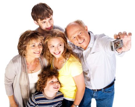 Happy family pilled together and taking self portrait.