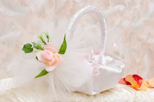 Small pretty basket decorated by tapes and an artificial flower