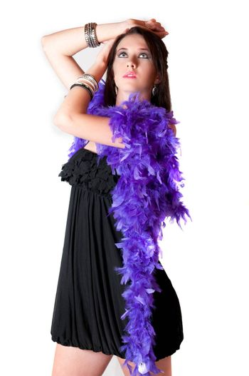 Beautiful sexy brunette model with blue eyes in sexy purple scarf in black mini dress standing