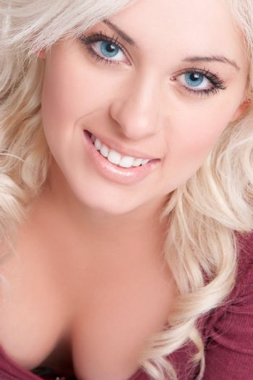 Beautiful smiling cheerful blond woman