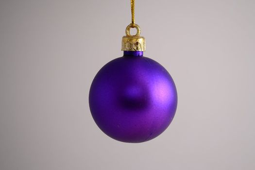 Single hanging purple Christmas ball