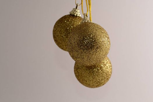 Three gold Christmas baubels