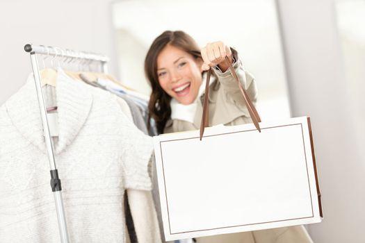 Shopping woman showing shopping bag