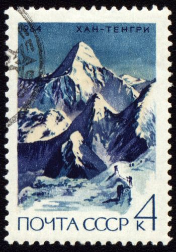 USSR - CIRCA 1964: stamp printed in USSR, shows mountain landscape with Khan Tengri peak (7010 m) in Central Tien Shan, circa 1964