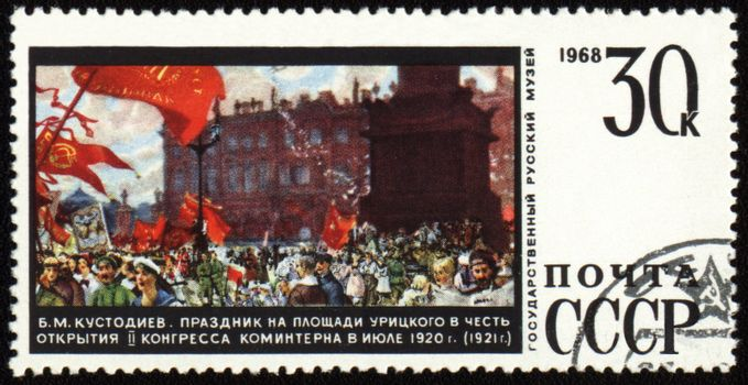 """USSR - CIRCA 1968: A stamp printed in the USSR shows picture """"Celebration on Uritsky Square in honor of the opening of II Congress of the Comintern in July 1920"""" by Boris Kustodiev, circa 1968"""