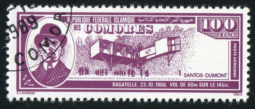 COMORO ISLANDS - CIRCA 1988: stamp printed by Comoro islands, shows airplane and Alberto Santos Dumont, circa 1988