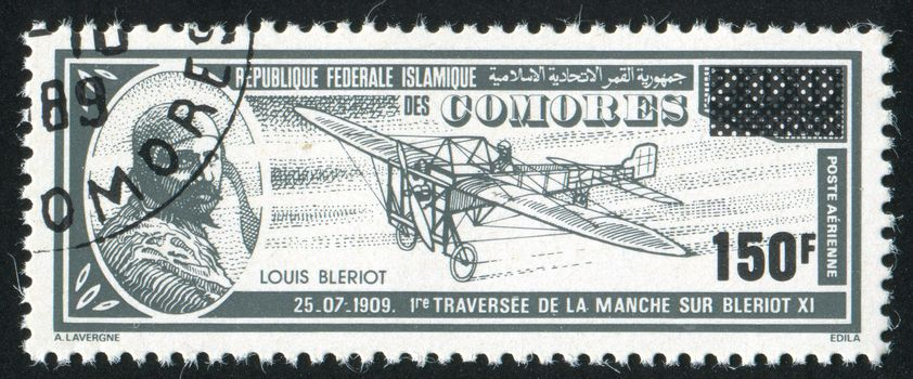 COMORO ISLANDS - CIRCA 1988: stamp printed by Comoro islands, shows airplane and Louis Bleriot, circa 1988