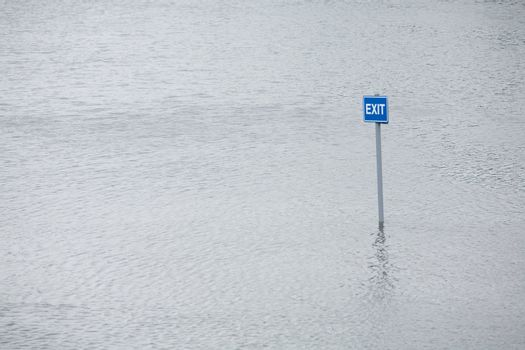 Exit sign in flooded car park