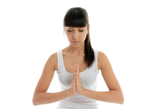 A young woman meditates  - holistic peace spirituality tranquility.