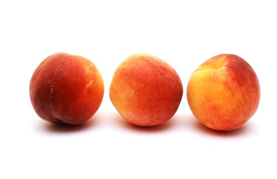 Foto of peaches placed on white background