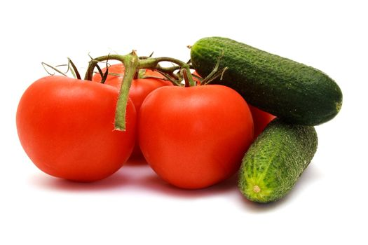 Foto of cucumbers  and tomatoes in room