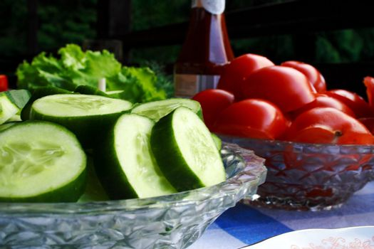 Foto of cucumber and tomatoes in dishes