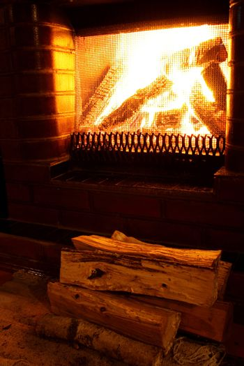 Foto of warm fireplace at late evening