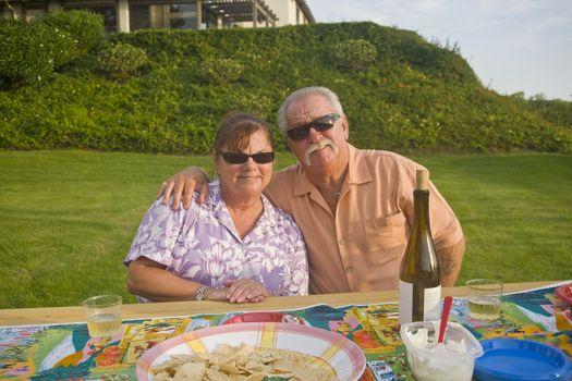 Senior Couple enjoys an outdoor Picnic