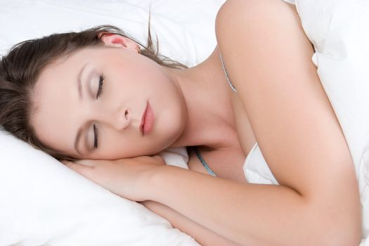 Beautiful young brunette woman sleeping