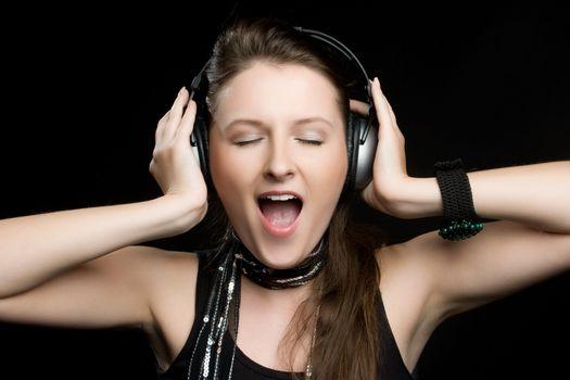 Beautiful woman singing headphones music