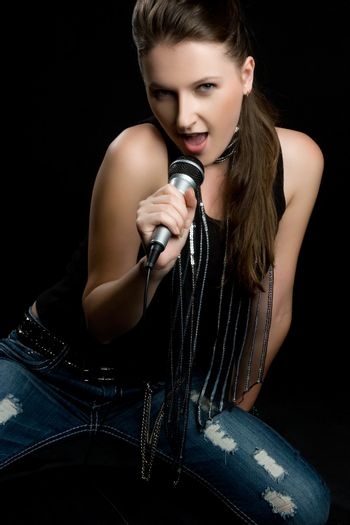 Pretty girl singing into microphone