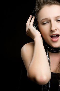 Beautiful girl singing wearing headphones